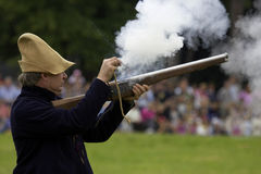 Musket being fired by a man Stock Images