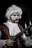 Musket and candle, gentleman rococo era wig. Gentleman rococo era wig, man dressed in vintage Royalty Free Stock Photography