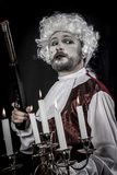 Musket and candle, gentleman rococo era wig Royalty Free Stock Images
