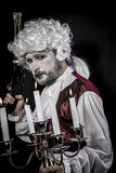 Musket, gentleman rococo era wig. Picture with male model, conceptual art Stock Photos