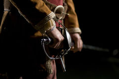 Musketeer o Swordsman over a Black Background Royalty Free Stock Images