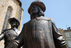 """The 2 musketeers. Statues of musketeers or """"Les Mousquetaires"""" in the village of Condom, Gers department, Midi-Pyrénées region. Located in Condom, St Royalty Free Stock Image"""