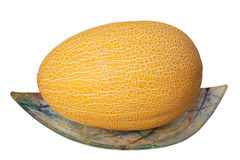 The muskmelon on the glass plate on white background Royalty Free Stock Photos