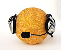 Muskmelon in headphone. A yellow muskmelon in a headphone isolated  on white background Royalty Free Stock Image
