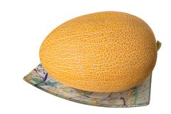 The muskmelon on the plate Stock Image