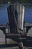 Muskoka chair by the lake Stock Images