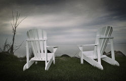 Muskoka chairs. By the lake in ontario Canada Royalty Free Stock Images