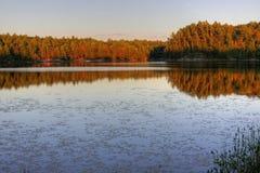 Muskoka sjö på solnedgången Arkivbild