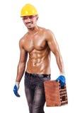 Muskulös byggmästare med tegelstenar Royaltyfri Bild