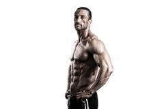 Muskulös kroppsbyggare Guy Posing Over White Background Arkivfoto