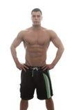 Muskulös kroppsbyggare Guy Posing Over White Background Royaltyfri Foto
