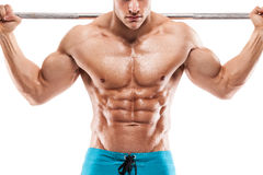 Muskulös kroppsbyggaregrabb som gör övningar med hantlar över whi Royaltyfri Foto