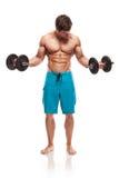 Muskulös kroppsbyggaregrabb som gör övningar med hantlar Royaltyfri Bild