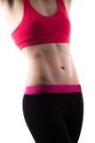 Muskulös kvinnlig mage Arkivfoton