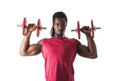 Muskulös sexig ung svart man som övar biceps royaltyfria bilder