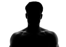 Muskulös silhouette av en ung man royaltyfria bilder