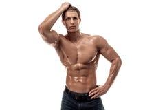Muskulös stilig ung man med den nakna torson bakgrund isolerad white Royaltyfria Foton