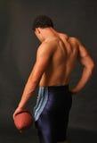 muskulös tillbaka blå fotboll royaltyfri fotografi