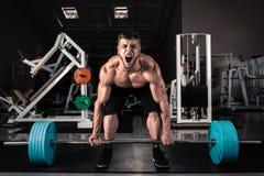 muskulösa män Arkivfoto