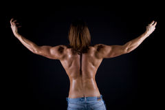 Muskulöse Mannesrückseite Stockbilder