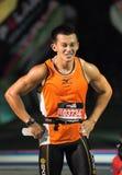 Muskulöse Manngrimasse in den Schmerz nach Marathonlack-läufer Lizenzfreies Stockfoto
