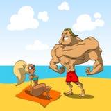 Muskulöser Kerl auf dem Strand mit einem heißen Mädchen Lizenzfreies Stockfoto