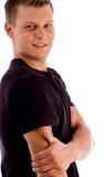 Muskulöser Mann, der seine Hand anhält Lizenzfreie Stockbilder