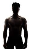 Muskulöser Mann im Schattenbild Stockfoto