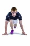 Muskulöser Rugbyspieler in laufender Position stockfotos