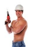 Muskulöses Mann-Holding-Bohrgerät lizenzfreie stockbilder