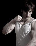 Muskulöses Mannlochen Stockfoto