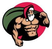 Muskulösa Santa Claus kommer med en påse mycket av julgåvan Royaltyfri Foto