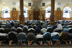 Muslem prayer at a mosque of Yangon. Burma Royalty Free Stock Photo
