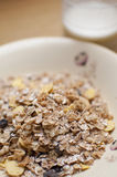 Musli cereal and milk in bowl Stock Images