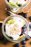 Musli served with joghurt and fresh fruits Stock Photo