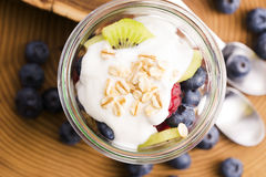 Musli served with joghurt and fresh fruits Royalty Free Stock Images