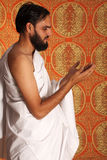 Muslim. Pilgrim in white traditional clothes stock photo