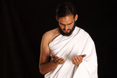 Muslim. Pilgrim in white traditional clothes stock photos