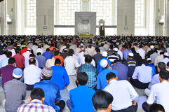 Muslim. Crowd sitting in horizontal lines , listening to Friday sermon in a mosque in Malaysia Royalty Free Stock Photo