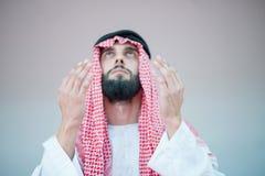 Muslim Arabic man praying Stock Image