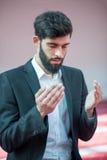 Muslim Arabic man praying Stock Photos