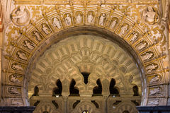 Muslim Arch with Christian Reliefs in Mezquita Stock Image