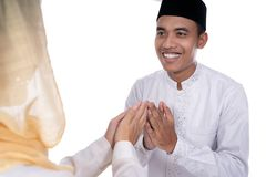Muslim asian people forgiving. On eid mubarak tradition. apologizing each other isolated over white stock images