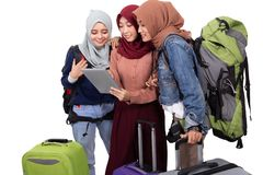 Muslim asian woman friend sitting in airport terminal royalty free stock photo