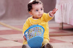 Muslim baby girl. Arabian egyptian muslim baby girl playing Royalty Free Stock Photo