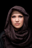 Muslim beautiful girl. Portrait of Middle Eastern young girl on a dark background Royalty Free Stock Image