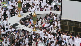 Muslim believers at hicr ismail next to Kaaba in Mecca Editorial stock footage