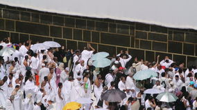 Muslim believers at the wall of holy Kaaba in Mecca stock video footage