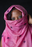 Muslim black woman covering  mouth with veid Royalty Free Stock Images