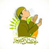 Muslim boy and Arabic calligraphy text for Ramadan Kareem. Royalty Free Stock Photo